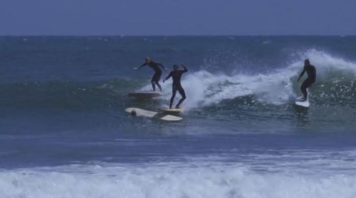 Surfers colliding