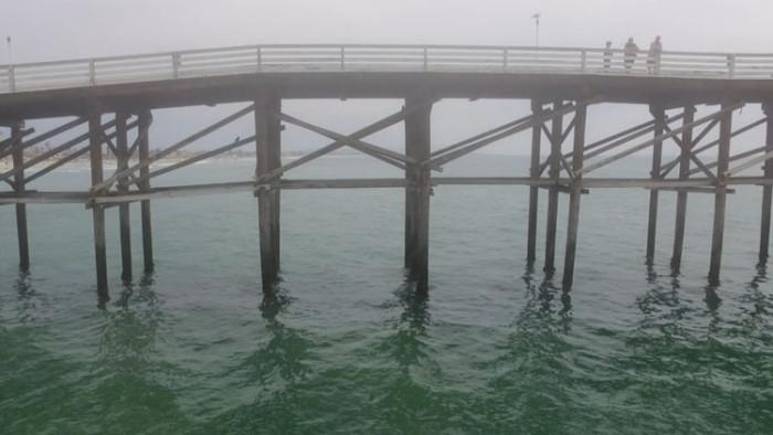 PB Pier surfing