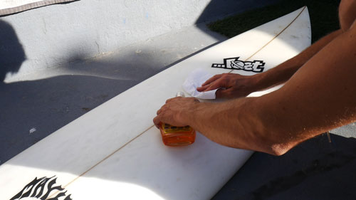 Clean surfboard with household cleaner