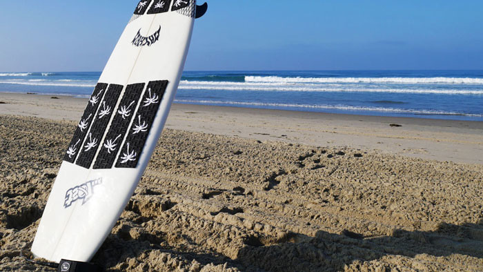 Surfboard front traction pad
