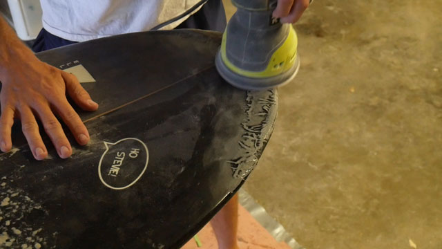 Sanding surfboard nose