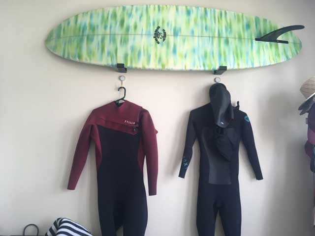 Funboard surfboard hanging on wall