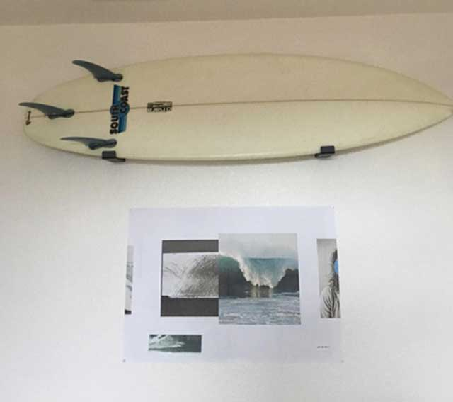 Shortboard surfboard hanging on wall