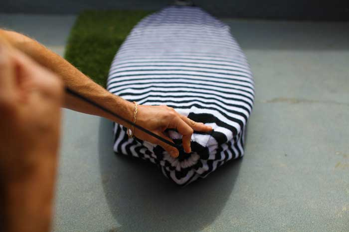 Drawstring closure protects your surfboard's tail