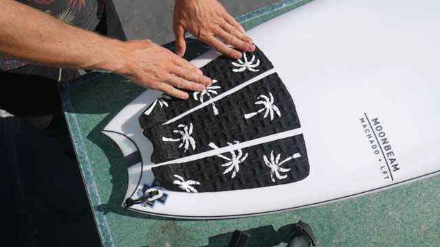 Surfboard tail pad application