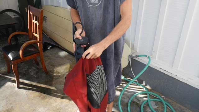 Slide hanger into wetsuit neck